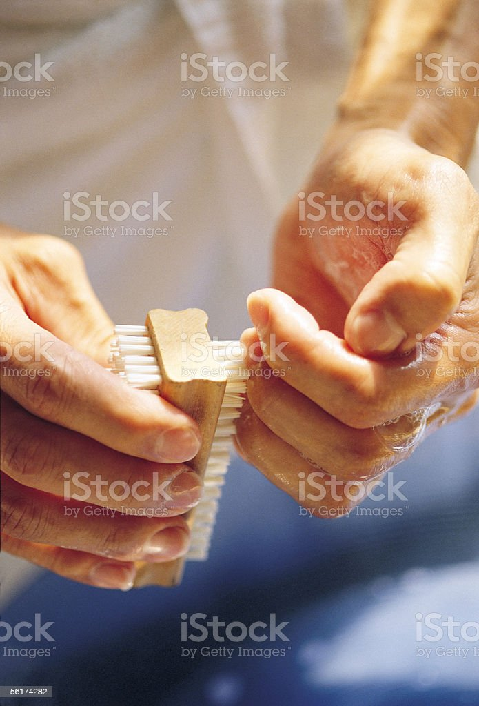 Cleaning nails stock photo