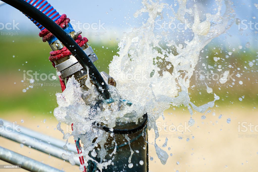Cleaning newly constructed water bore or well with air compressor stock photo