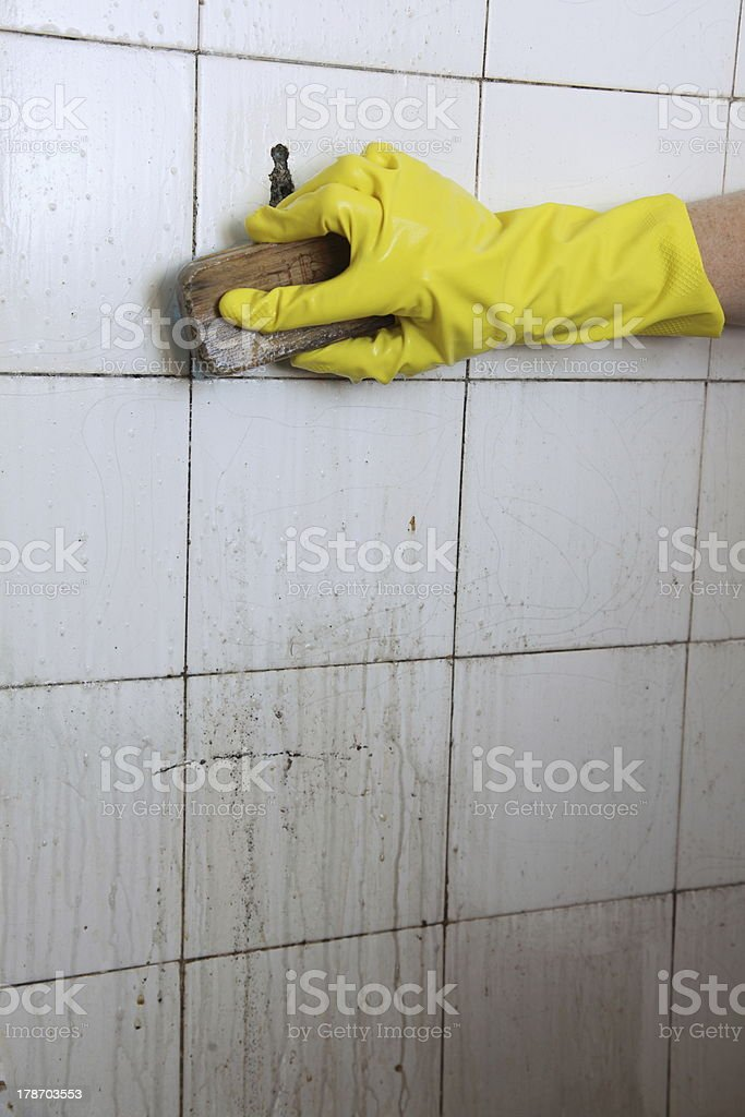 Cleaning of dirty old tiles in a bathroom royalty-free stock photo