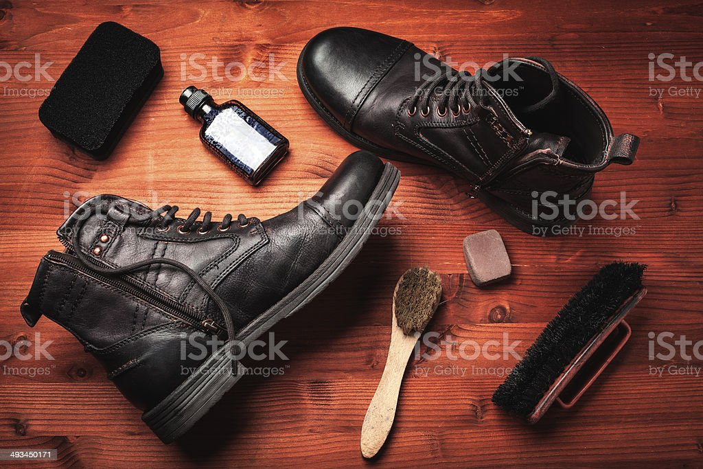 cleaning of men's boots stock photo