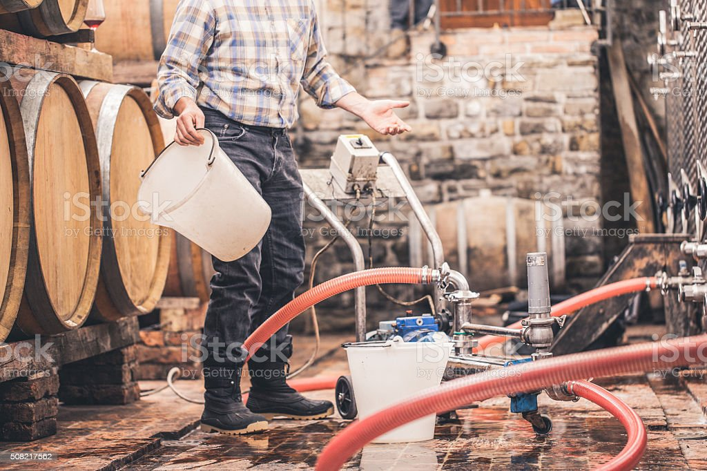 Cleaning of Pipes in Wine Cellar stock photo