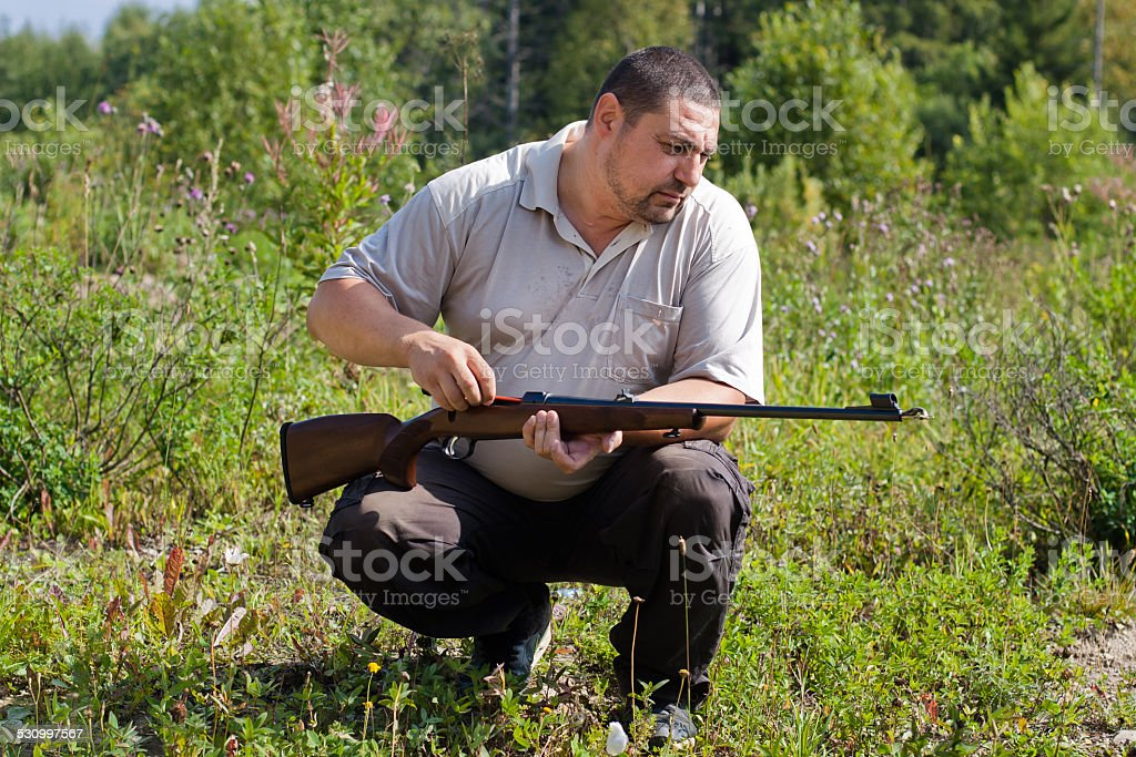 cleaning of rifles stock photo