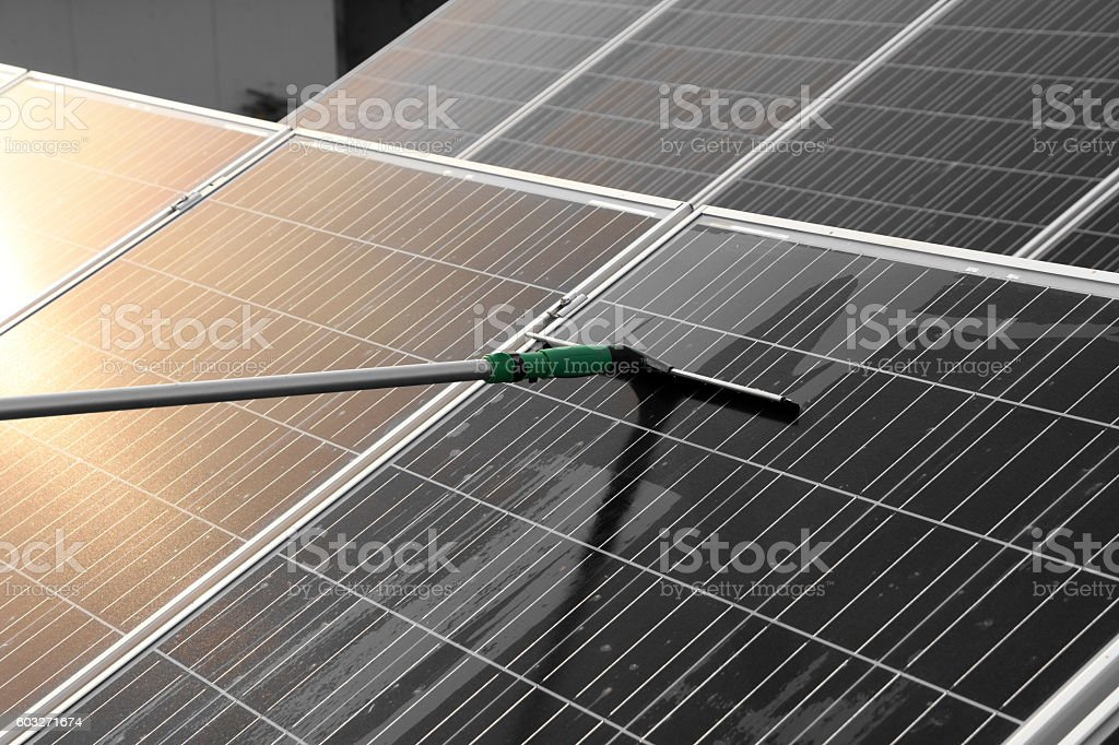 Cleaning of solar panels stock photo