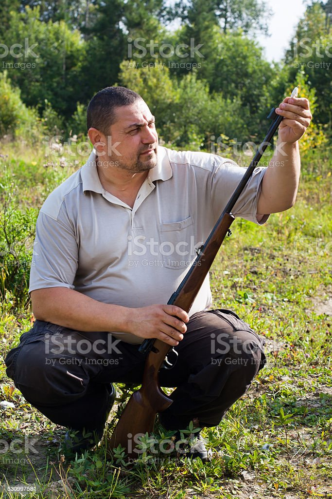 cleaning of weapons stock photo