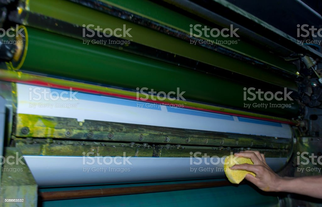 cleaning offset printing rollers stock photo