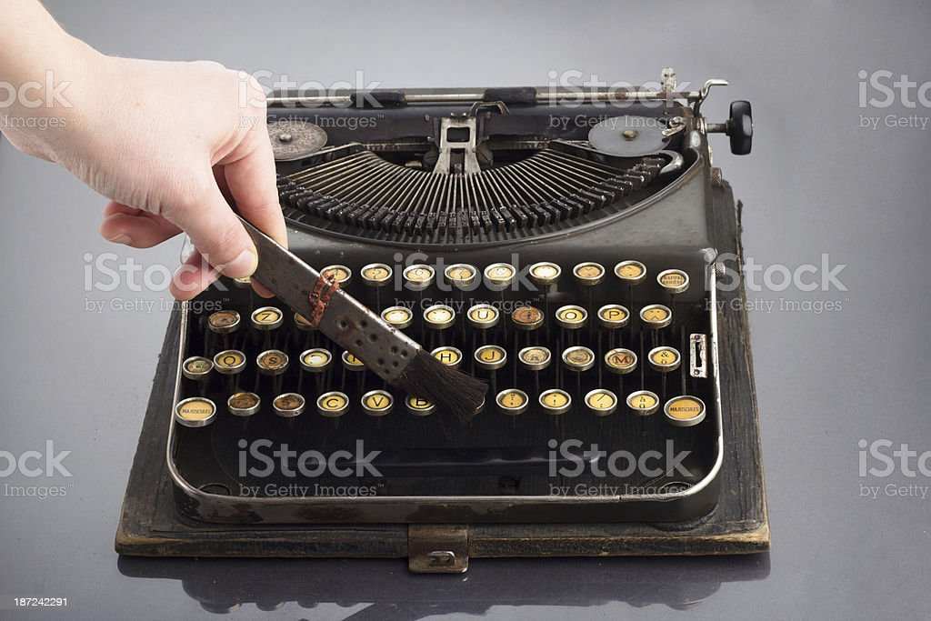 Cleaning Old Vintage Typewriter royalty-free stock photo