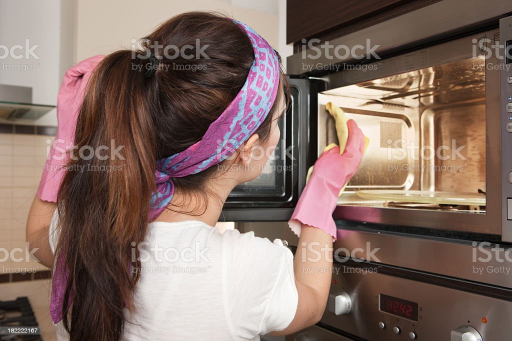 Cleaning oven stock photo