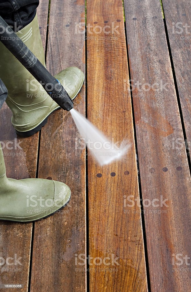 Cleaning Patio Decking With a Pressure Hose royalty-free stock photo