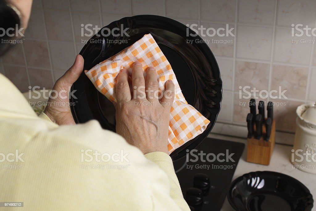 Cleaning plates in the kitchen stock photo