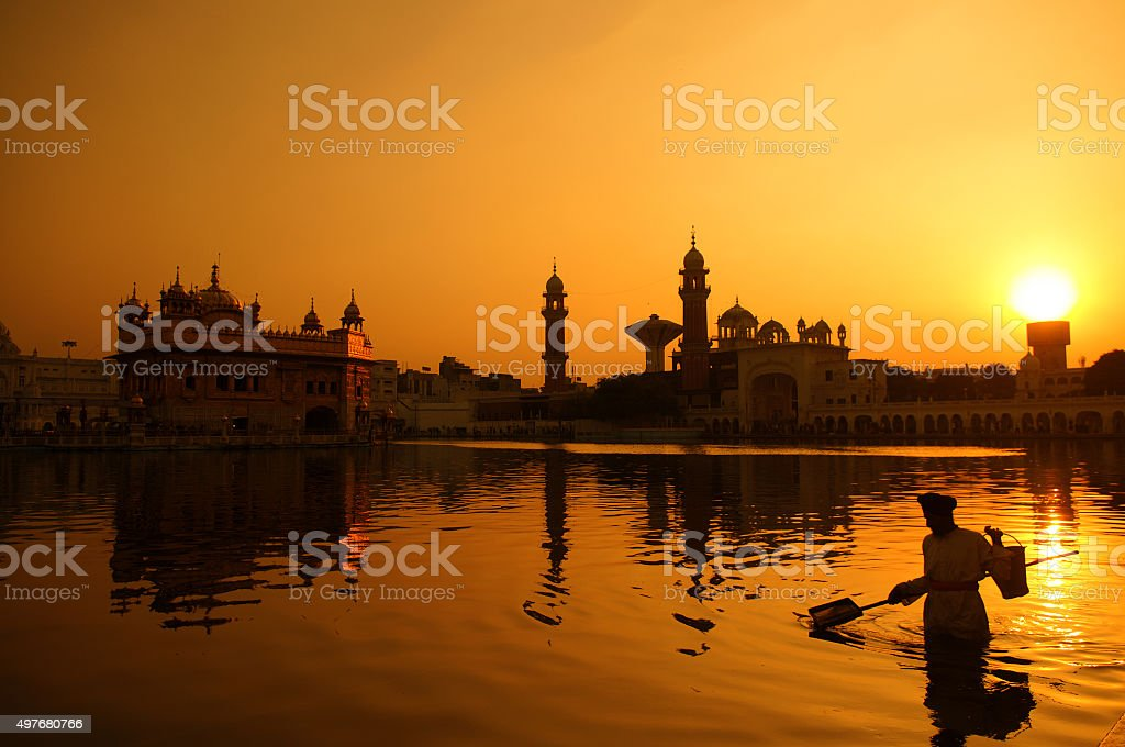 Cleaning pool of the Golden Temple, India stock photo
