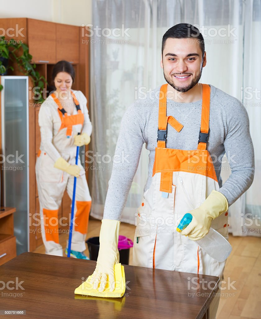 Cleaning premises team to work stock photo