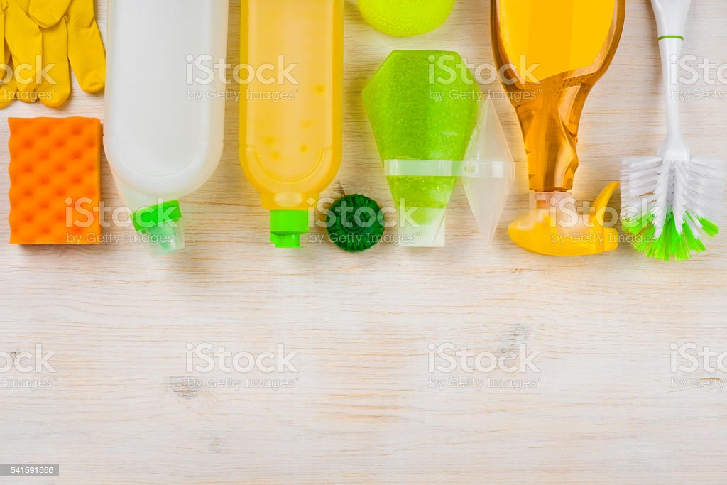 Cleaning products on wooden background with copy space at bottom stock photo