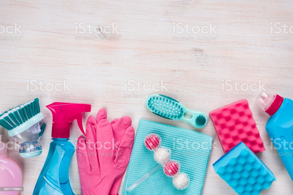 Cleaning products on wooden background with copyspace at the top stock photo