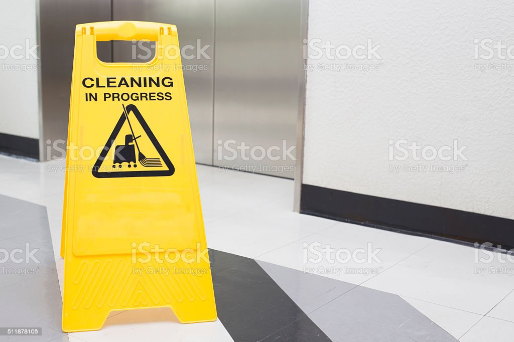 cleaning progress caution sign in office stock photo
