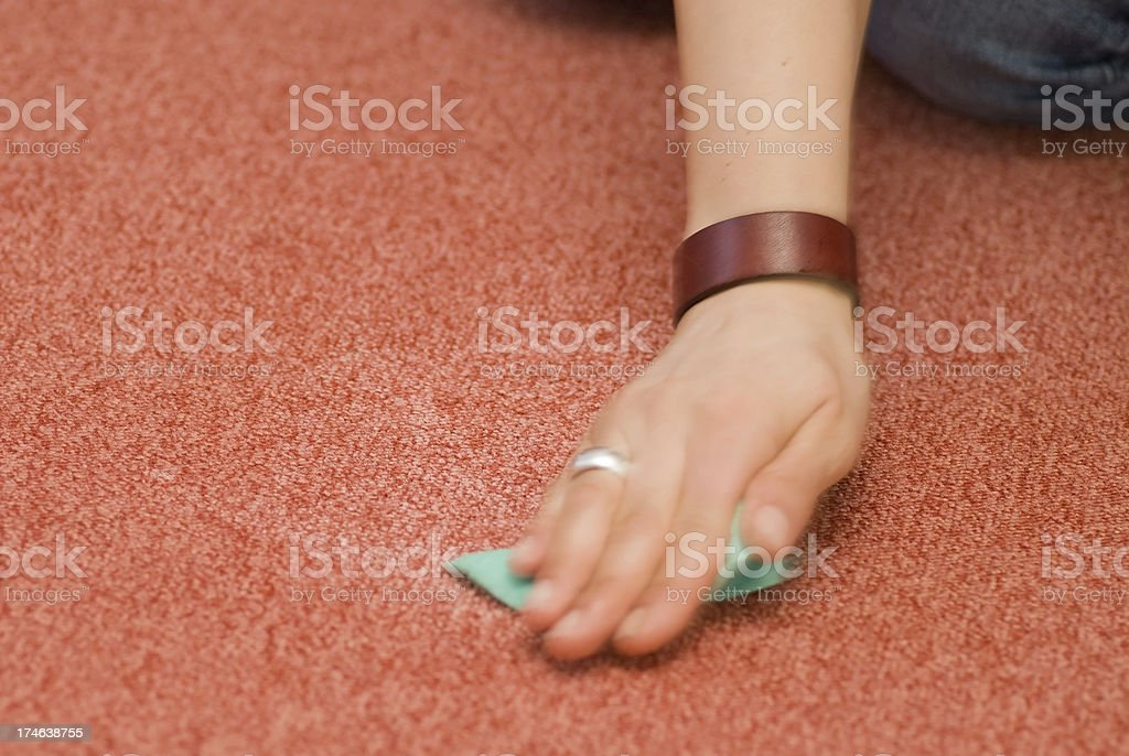 cleaning red carpet - Teppichreinigung per Hand stock photo