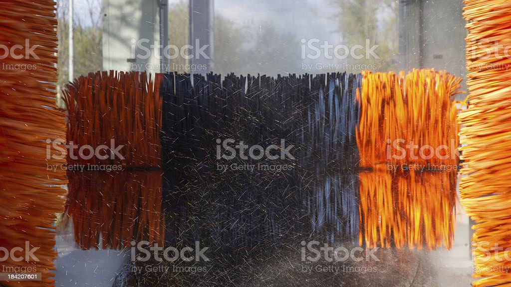 Cleaning rollers rotating car wash tunnel - Rodillo stock photo