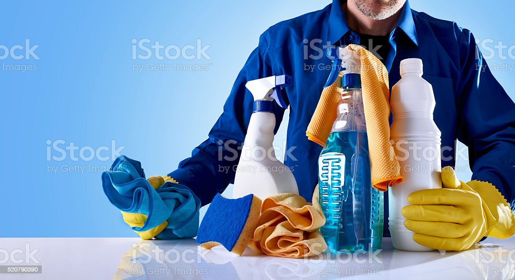 Cleaning service products and uniformed employee stock photo