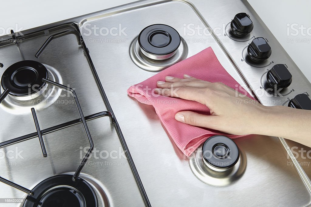 Cleaning set-top stove stock photo