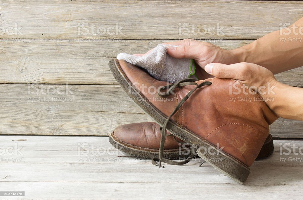 Cleaning shoes stock photo