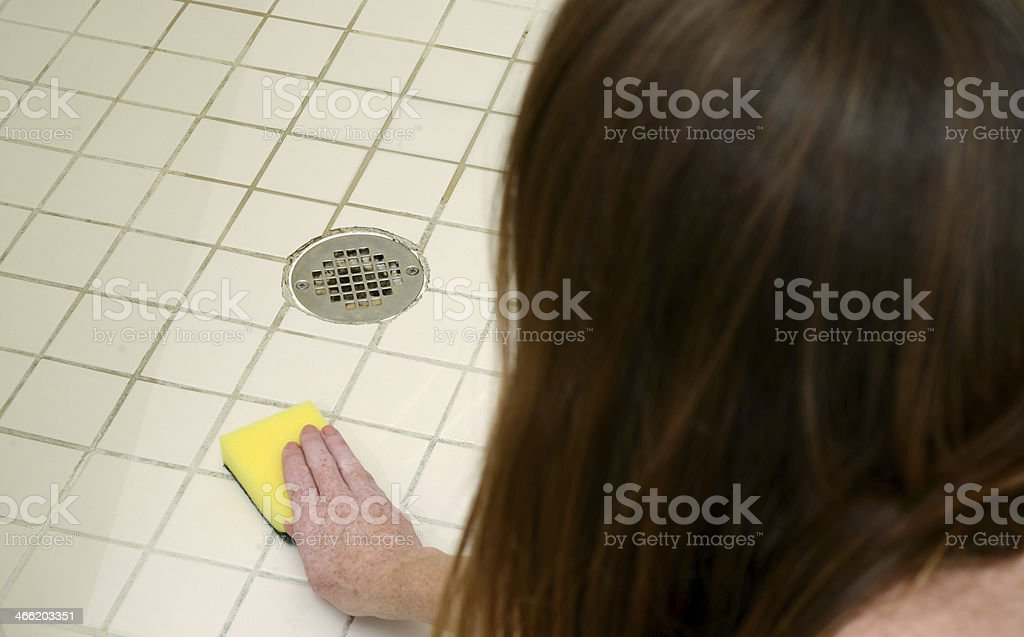 cleaning shower with scour pad royalty-free stock photo