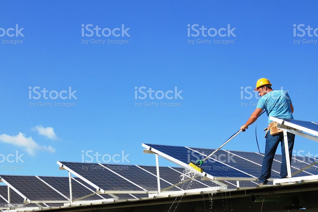 Cleaning solar panels stock photo