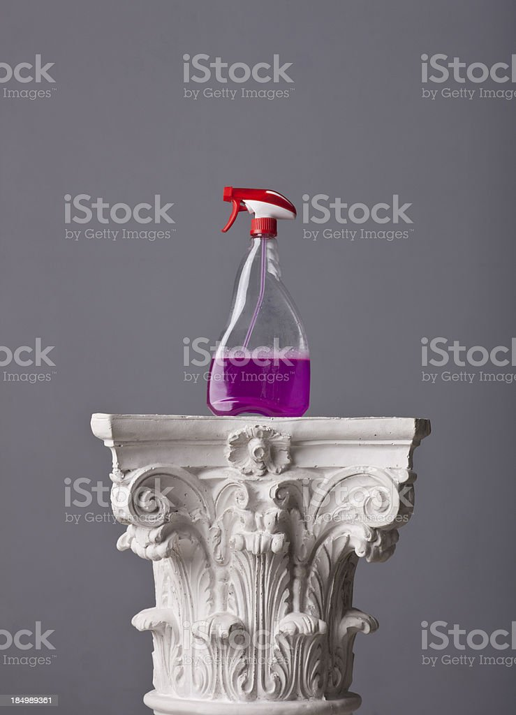 cleaning solution bottle on a corinthian capital stock photo