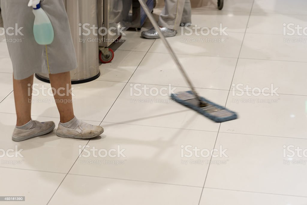 Cleaning staff of the building doing her daily job stock photo