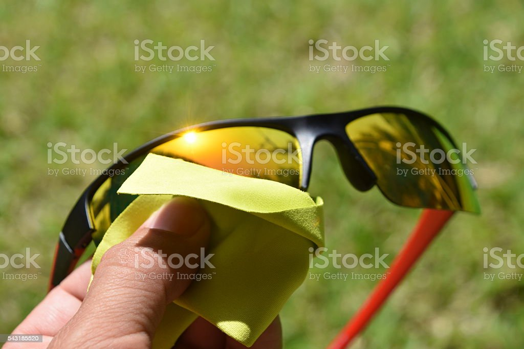 Cleaning Sunglasses stock photo