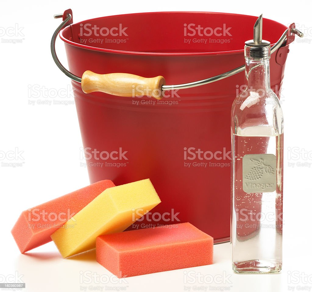 Cleaning supplies with a red bucket, sponges, and a bottle stock photo