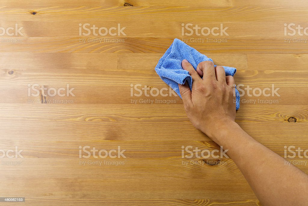 Cleaning table by hand stock photo