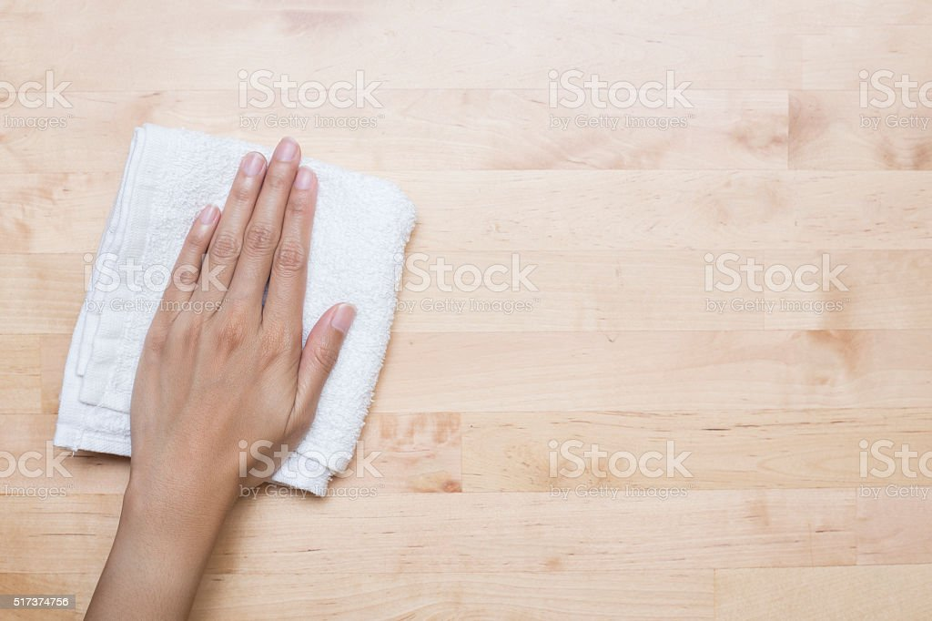 Cleaning table by woman hand stock photo