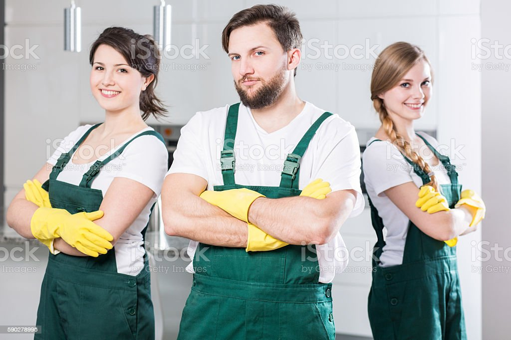 Cleaning team ready to clean the dirtiest room stock photo