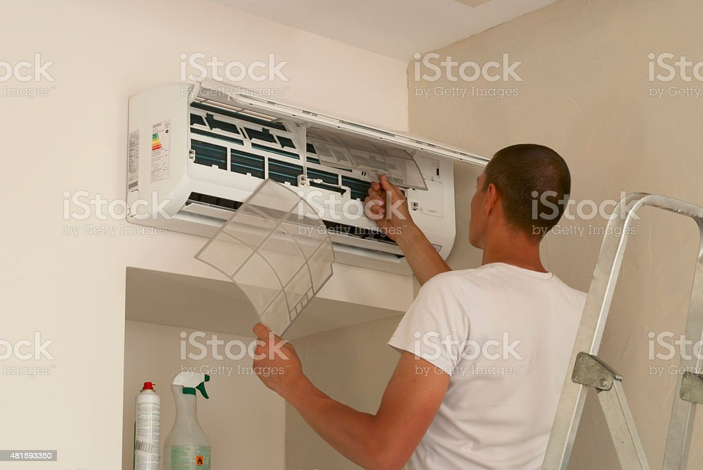 cleaning the air conditioner stock photo