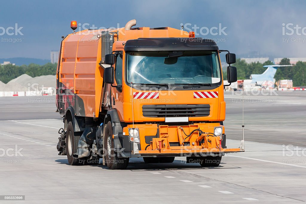 Cleaning the airport apron of the vacuum sweeper truck royalty-free stock photo