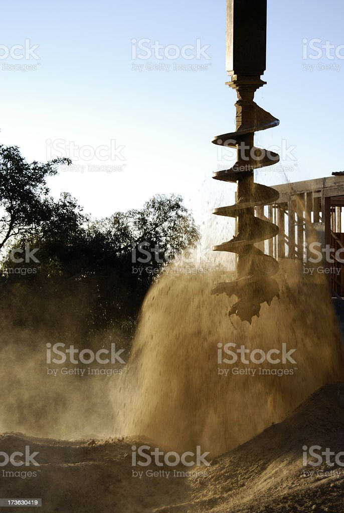 Cleaning the auger royalty-free stock photo