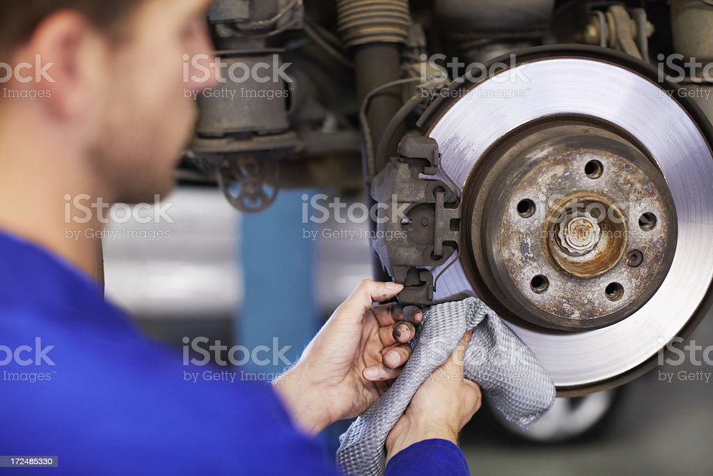 Cleaning the brake plate royalty-free stock photo