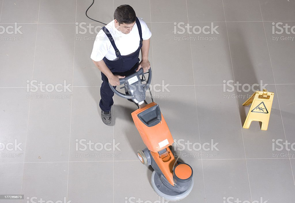 cleaning the floor with machine stock photo