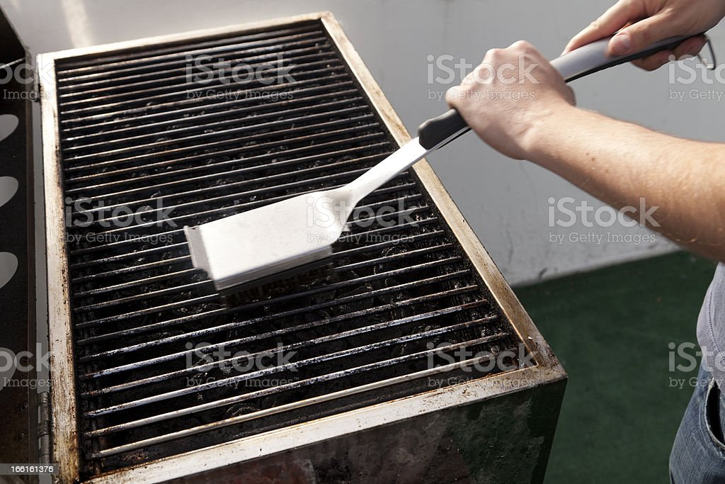 Cleaning the Grill stock photo