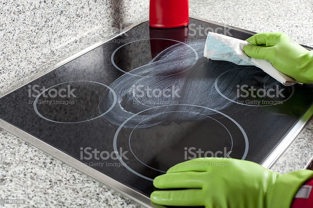 Cleaning the hob stock photo