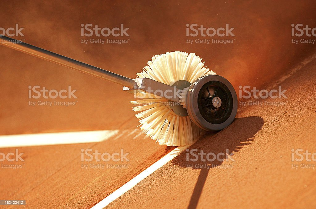 Cleaning the lines on a clay tennis court stock photo