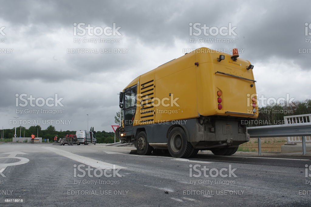 Cleaning the new road stock photo