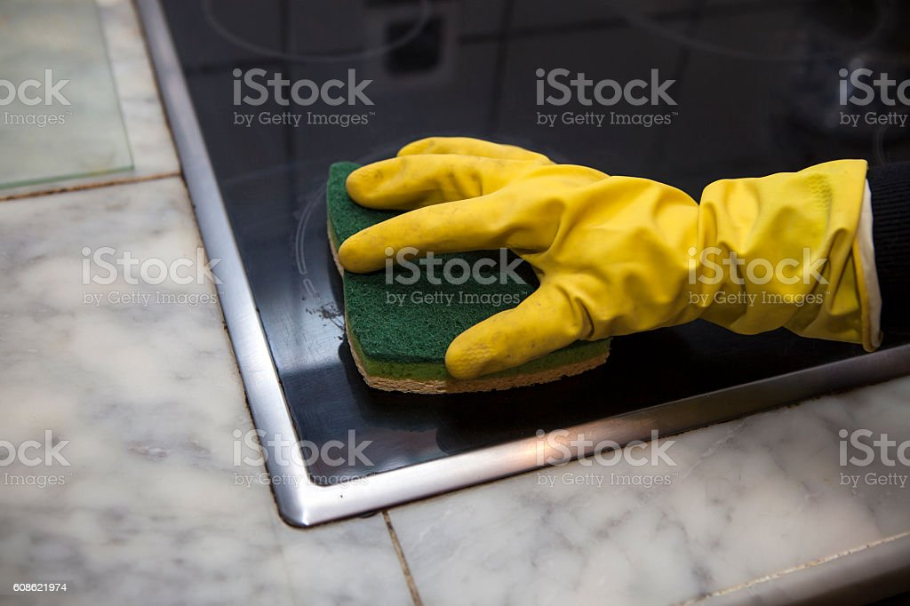 Cleaning the oven stock photo