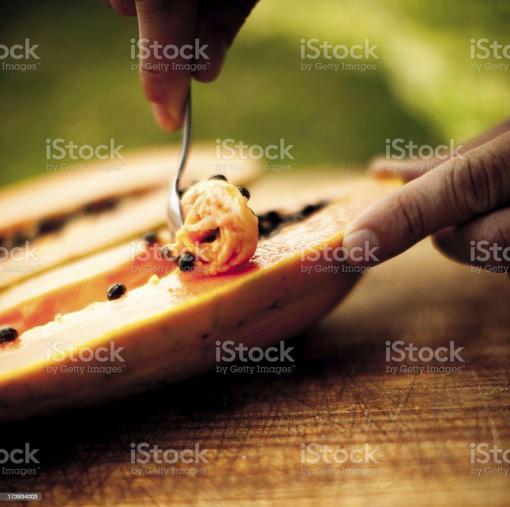 Cleaning the papaya stock photo