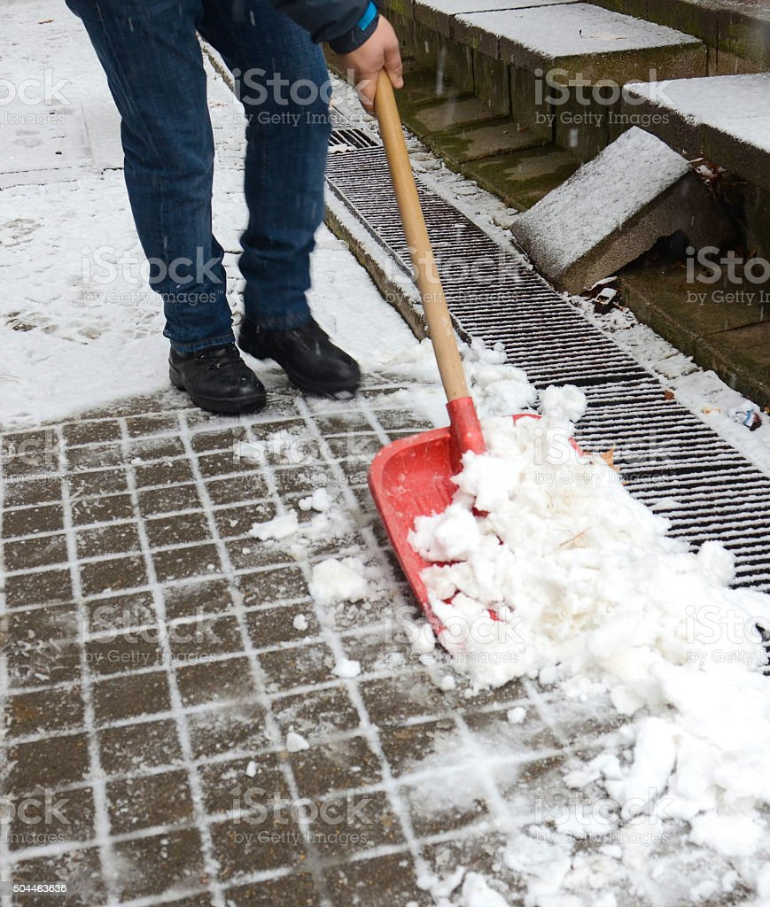 cleaning the snow stock photo