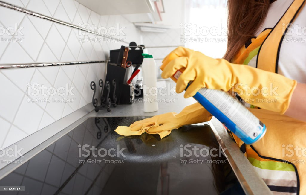 cleaning the stove stock photo