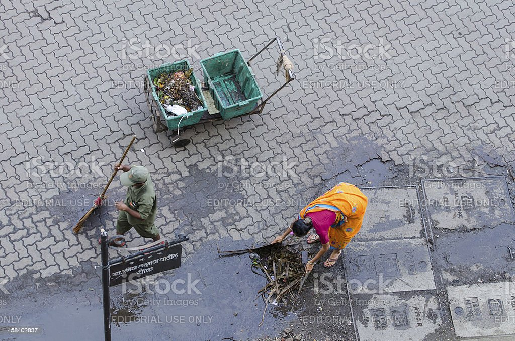 Cleaning the streets in Mumbai royalty-free stock photo