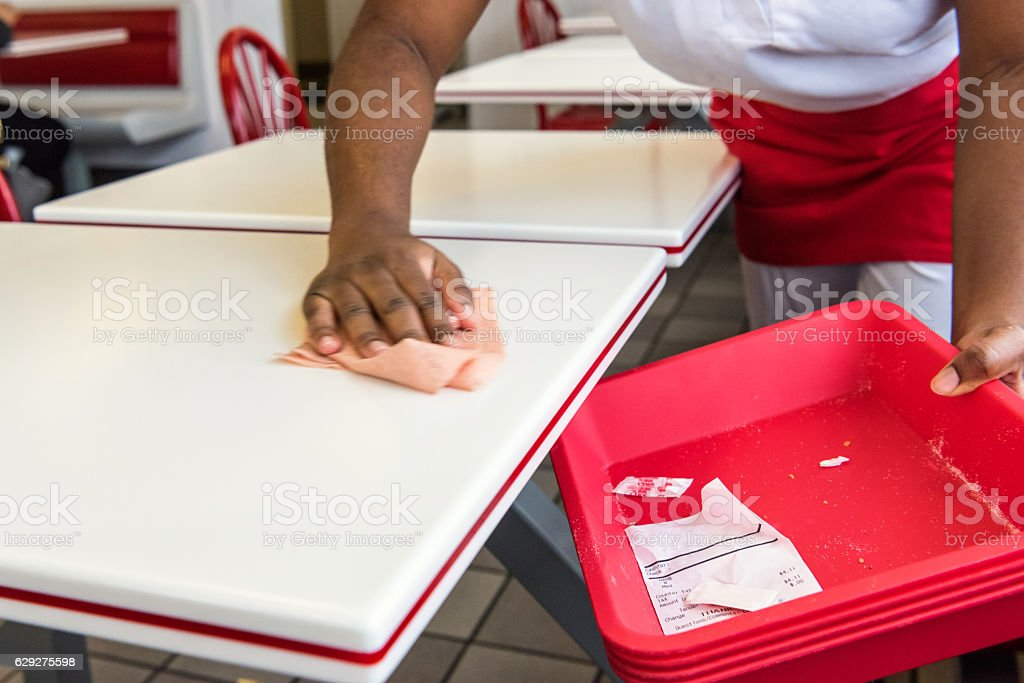Cleaning the table stock photo