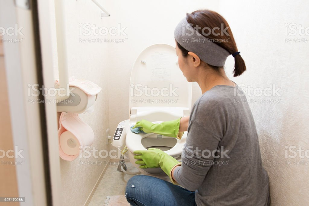 Cleaning the toilet stock photo