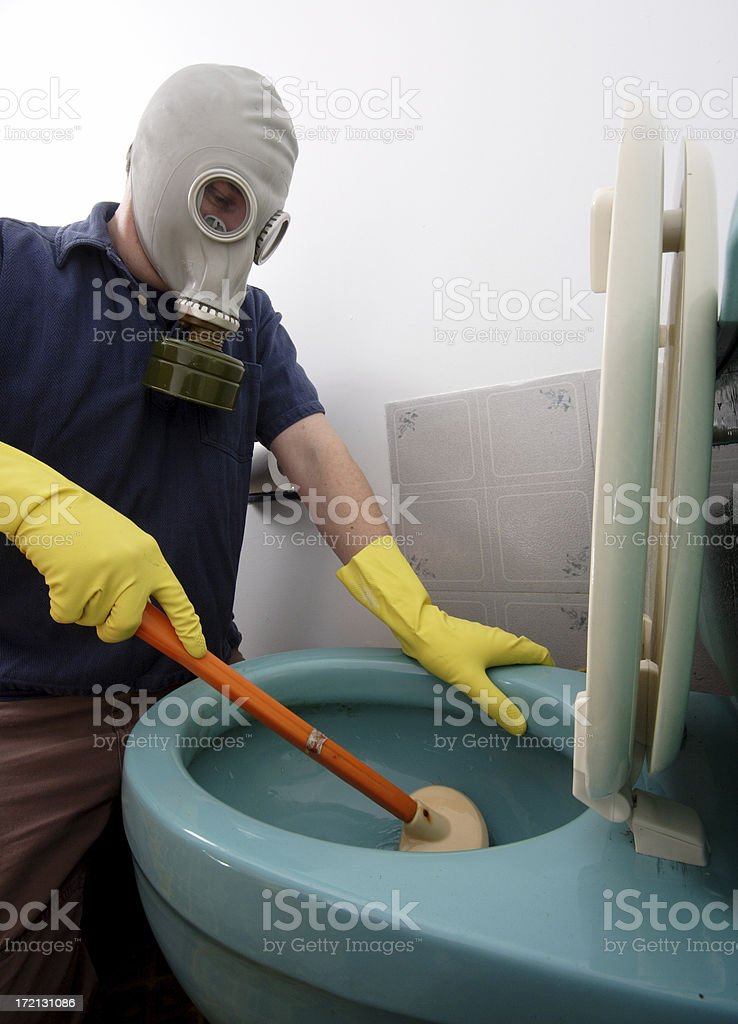 Cleaning the toilet, taking precautions royalty-free stock photo