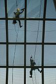 Cleaning the vast glass panels of Bangkok Airport.
